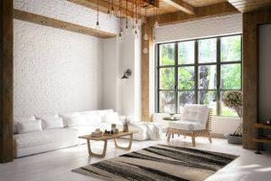Salon avec baies vitrées et canapé blanc de chalet